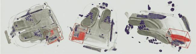 ภาพการสแกนกระเป๋าด้วยเครื่องสแกนแบบ CT (สีแดง คือ ระเบิดชนิด C4) (ที่มาของภาพจาก http://www.eetimes.com/document.asp?doc_id=1163165)